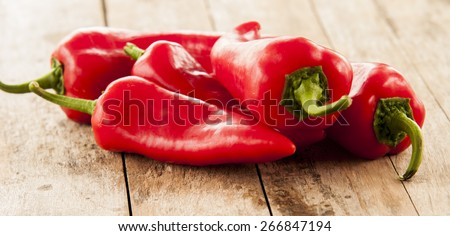 red pepper on wooden table - stock photo