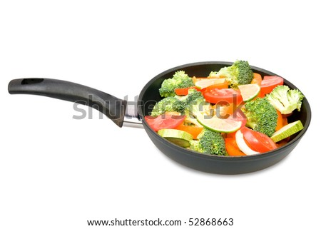 Red pepper, tomatoes, vegetable marrows and broccoli in a frying pan