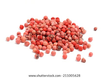 red peppercorn on white background - stock photo
