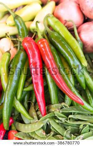 Red peppers,Cayenne pepper, chili spur pepper, long fed pepper, spur pepper, Capsicum annuum Linn. Var acuminatum Fingerh. ,a pile of small, red, very hot and spicy chilli peppers on an asian market.  - stock photo