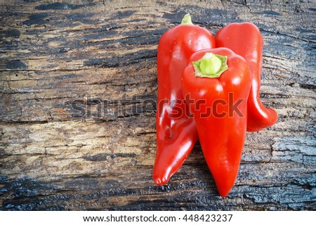 Red peppers on a wooden background