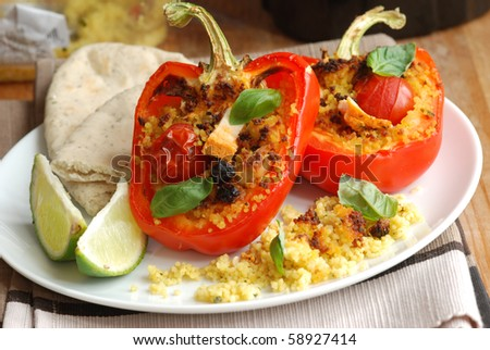 Red peppers stuffed with couscous - stock photo