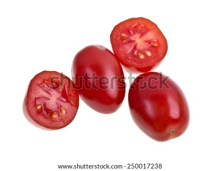 Red Perino tomatoes on a white background - stock photo