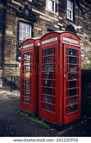 Red phone booth in Edinburgh. The red telephone box is a famous feature of the British landscape.  - stock photo