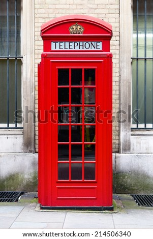 red phone booth in London, England - stock photo