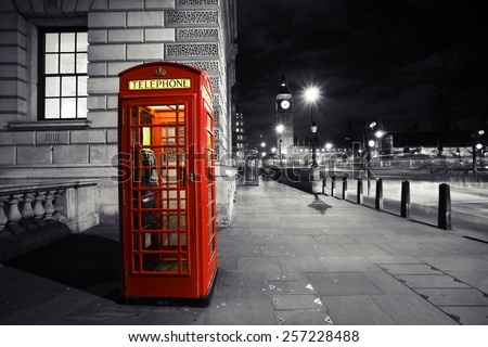 Red phone booth, in Parliament Square, one of the most famous icons of London, Big Ben is in the far behind.
