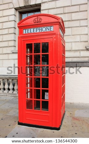 Red phone booth  on the street of the United Kingdom - stock photo