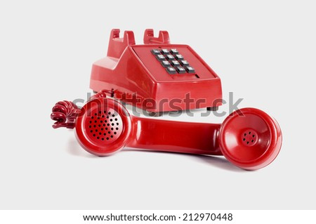 Red phone with the handset off the hook - stock photo