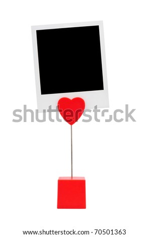 Red photography holder with instant photo card isolated on a white background. - stock photo