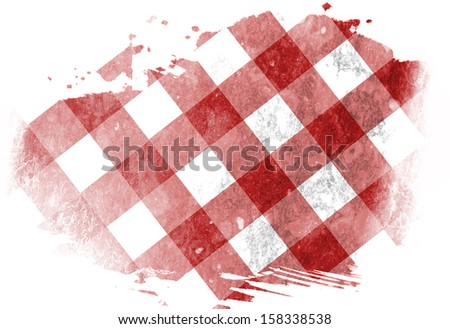 red picnic cloth with some squares in it - stock photo
