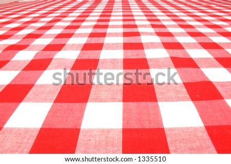 Red picnic table cloth - stock photo