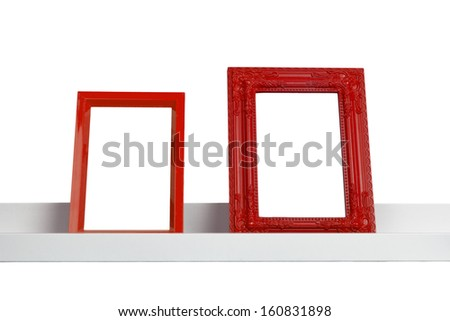 red picture frames on the shelf - stock photo