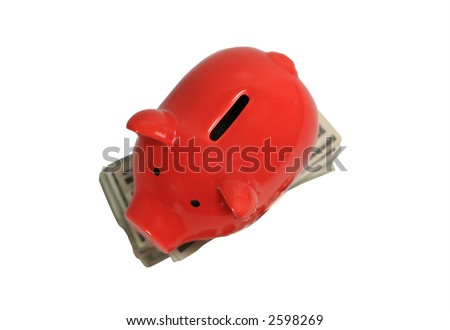 Red piggy bank on top of stacks of money coins and dollars top view - stock photo