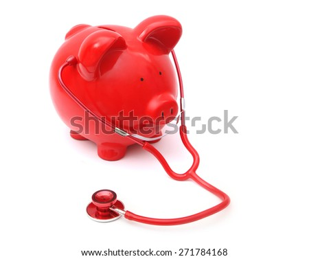 Red Piggy Bank wtih stethoscope on White Background - stock photo