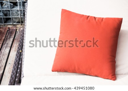 Red pillow on chair around swimming pool in hotel resort