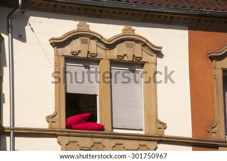 Red Pillows in the Window