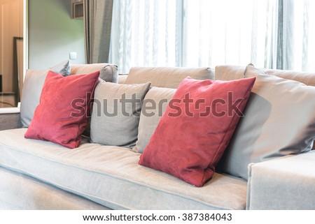 Red Pillows On Modern Grey Sofa Stock Photo 387384043 - Shutterstock
