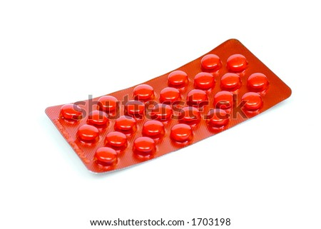 red pills in a blister isolated on white background