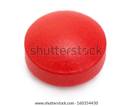 Red pills on a white background, isolated