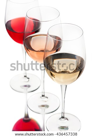 Red, pink and white wine in glasses on a white background