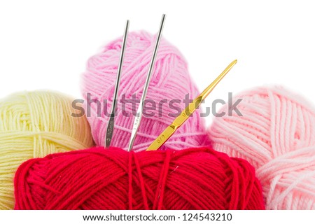 Red,Pink,Yellow ball of wool and knitting needles isolated on white background - stock photo