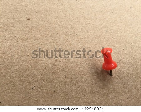 red pins on brown paper background - stock photo