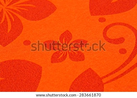 Red place mat texture for background, close-up image. - stock photo