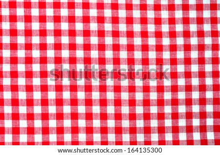 red plaid fabric as background
