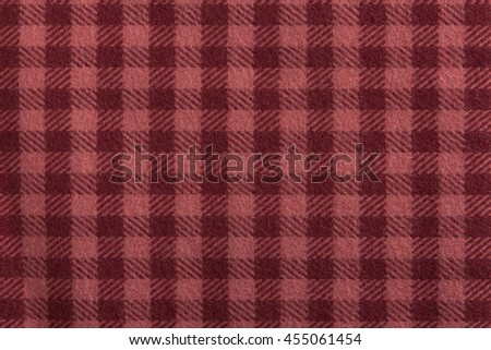 Red plaid fabric swatch textile background. - stock photo