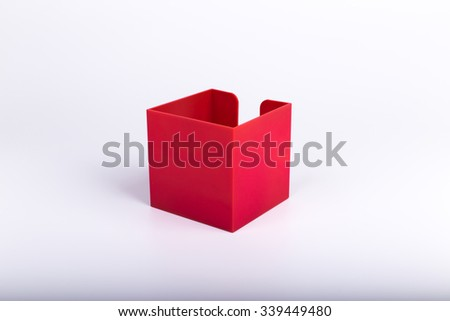 Red plastic box for office paper.