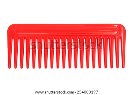 red plastic comb on a white background