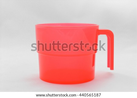 red plastic cup on a white background