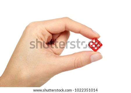 Red plastic dice in hand, isolated on white background. Leisure fun time.