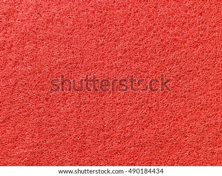 Red plastic doormat texture and background
