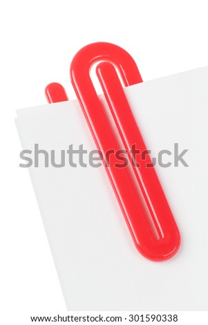 Red Plastic Paper Clip on White Background - stock photo