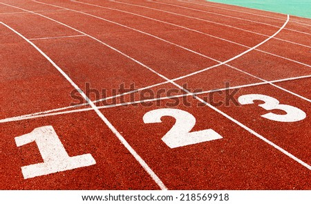 red plastic runway and numbers in a sports ground - stock photo