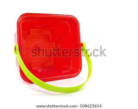 red plastic toy pail on a white background - stock photo