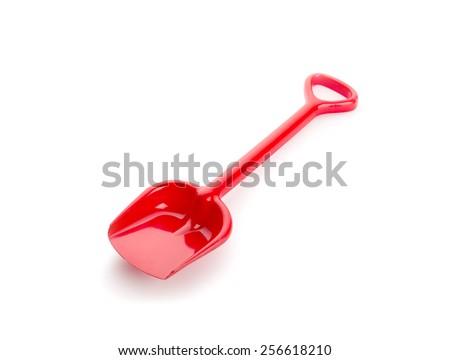 Red plastic toy shovel - stock photo