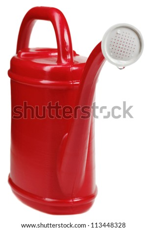 red plastic watering can. isolated on white background