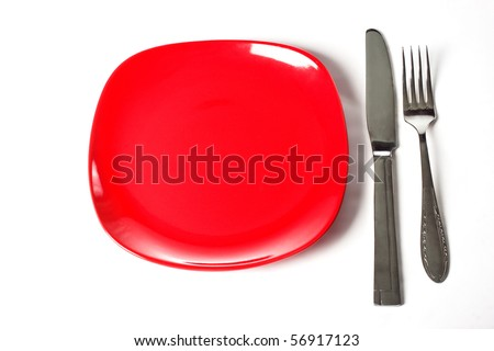 Red plate, knife and fork isolated on white background - stock photo