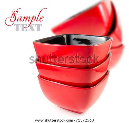 Red plates on a white background - stock photo