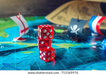 Red playing bones on world map stock photo 753369976 shutterstock red playing bones on the world map of the field handmade board games with a pirate gumiabroncs Choice Image