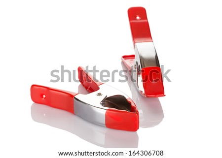 Red pliers. Manual tool. Isolated on white background close up.