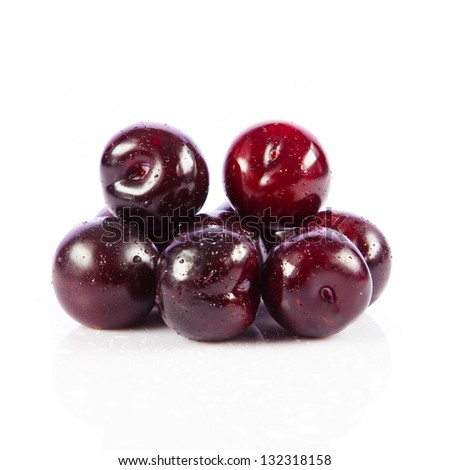 Red plum fruit isolated on white background. Fresh ripe washed plums
