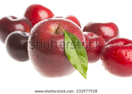 Red plums,apple, isolated on white background