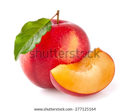 Red plums with leaves - stock photo