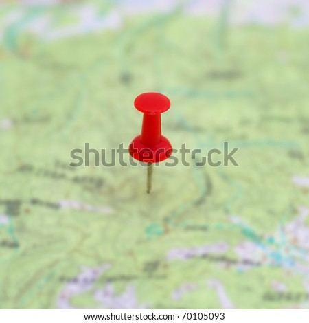 Red point on the map- concept background - stock photo