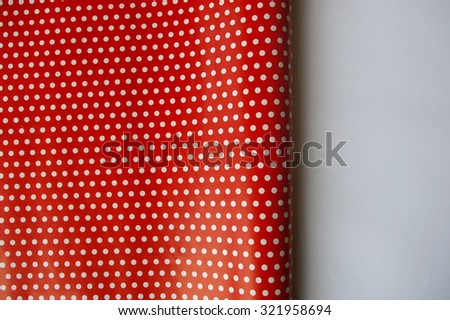 Red polka dot wrapping paper - stock photo