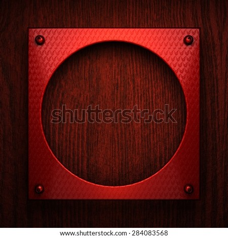red pollished metal on wooden bachkround