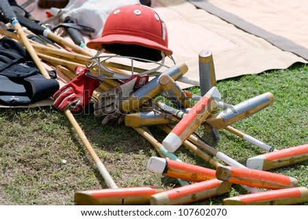 Red Polo hat and mallet - stock photo